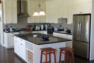 Traditional Kitchen with L-shaped, Flat panel cabinets, Undermount sink, Stainless steel appliances, Built in wine rack