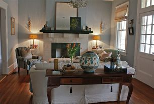 Eclectic Living Room with Chandelier, stone fireplace, Hardwood floors, Butler Masterpiece Channing Console Table