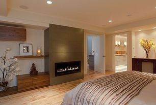 Contemporary Master Bedroom with Hardwood floors, Built-in bookshelf