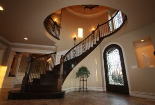 Traditional Staircase with High ceiling, Recessed lighting, Chair rail, Crown molding, Wall sconce, Curved banister