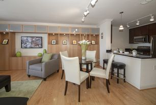 Contemporary Great Room with flush light, Crown molding, Pendant light, Laminate floors