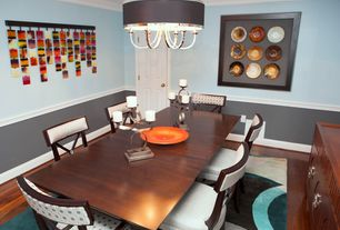Contemporary Dining Room with Chair rail, Pendant light, Crown molding, Laminate floors