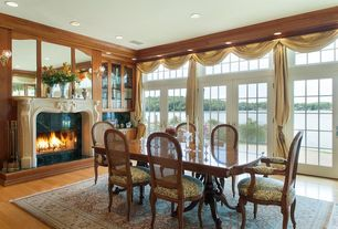 Traditional Dining Room with Wall sconce, Laminate floors, Built-in bookshelf, Transom window, Crown molding, High ceiling