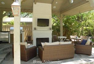 Traditional Patio with Outdoor kitchen, Fence, exterior stone floors