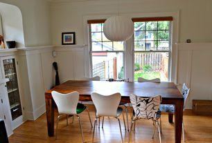 Craftsman Dining Room with Standard height, Crown molding, Chair rail, Hardwood floors, flush light, Wainscotting