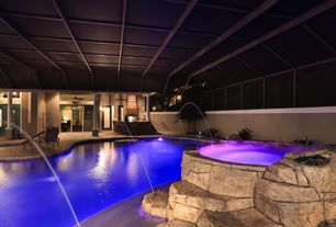 Mediterranean Swimming Pool with exterior stone floors, Outdoor kitchen, Pool with hot tub, Indoor pool, Pathway