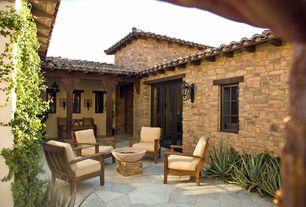"Mediterranean Patio with Bellagio collection 24"" high outdoor wall light, Concrete fire bowls round 27'', Veranda club chair"