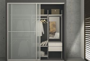 Modern Closet with Concrete tile , Louvered door, Built-in bookshelf