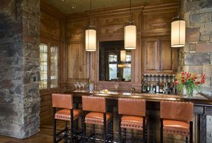 Rustic Bar with Crown molding, High ceiling, Lisette leather counter stool, Oron island light, Pendant light, Hardwood floors