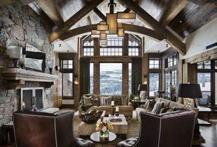 Contemporary Great Room with Built-in bookshelf, French doors, flush light, Eldorado stone broken top, Transom window