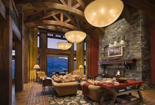 Rustic Living Room with Hardwood floors, Eldorado Stone Willamette Broken Top, Columns, can lights, picture window, Fireplace
