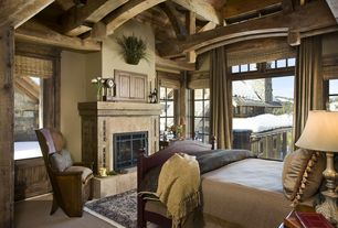 Rustic Guest Bedroom with Neutral, Carpet, Exposed beams, Wood frame windows, Stone tile fireplace