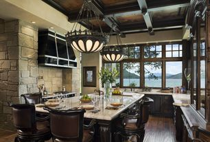 Traditional Kitchen with Custom hood, Glass panel, Complex Marble, partial backsplash, Interior stone wall, Breakfast bar