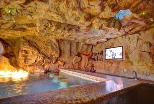 Rustic Swimming Pool with Faux rock, Artificial rock, Granite countertop in juparana persia, Swim up bar, Grotto