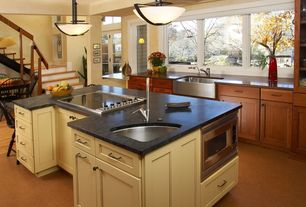Modern Kitchen with Breakfast bar, Farmhouse sink, Kitchen island, Casement, built-in microwave, electric cooktop, Flush