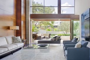 Contemporary Living Room with Modway coffee table, sliding glass door, Davis chair, High ceiling, Hardwood floors