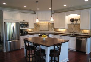 Cottage Kitchen with Hardwood floors, Wood counters, Crown molding, Kitchen island, Undercabinet lighting, Pendant light