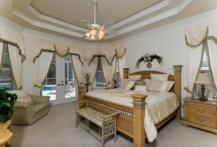 Traditional Master Bedroom with flush light, Crown molding, Ceiling fan, Carpet, French doors