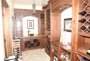 Traditional Wine Cellar with Pendant light, herringbone tile floors, Built-in bookshelf