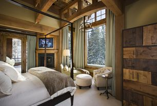 Rustic Master Bedroom with Abbyson Living Cabo Fabric Nailhead Trim Armchair, Inmod Wilshire Bed, Dark wood four poster bed