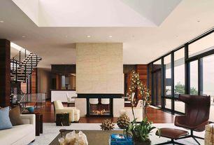 Contemporary Living Room with Hardwood floors, Transom window