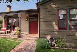 Cottage Front Door with Fence, Transom window, Pathway, exterior brick floors, Glass panel door, Gate