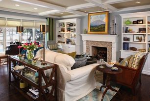 Traditional Living Room with Cement fireplace, Box ceiling, Hardwood floors, Built-in bookshelf