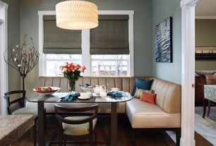 Contemporary Dining Room with Paint 1, Standard height, Hardwood floors, flush light, double-hung window, Bistro banquette