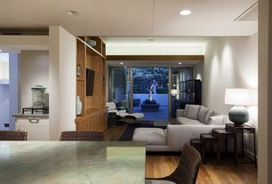 Contemporary Living Room with Hardwood floors, can lights, picture window, sliding glass door, Standard height