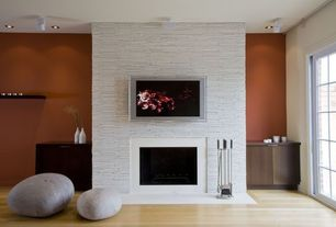 Contemporary Living Room with Built-in bookshelf, Norstone Rock Panel White, Laminate floors