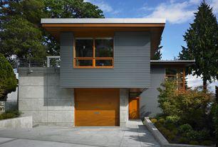 Contemporary Garage with Casement, six panel door, Concrete tile , specialty door, picture window, Standard height