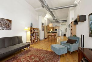 Contemporary Great Room with Built-in bookshelf, Hardwood floors, High ceiling, Wall sconce, Pendant light