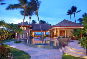 Tropical Exterior of Home with French doors, Pathway, Irregular bluestone flagging, Palm trees, Raised beds, Reflection pool