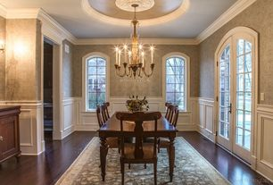 Traditional Dining Room with French doors, Wainscotting, Crown molding, Chair rail, Laminate floors, interior wallpaper