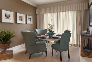 Traditional Dining Room with sandstone tile floors, Crown molding