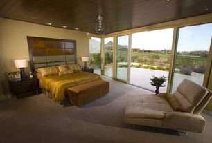 Contemporary Master Bedroom with Carpet, can lights, Standard height, Ceiling fan, Crown molding, interior wallpaper