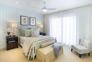 Traditional Guest Bedroom with Wainscotting, interior wallpaper, Carpet, can lights, Ceiling fan, sliding glass door