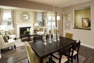 Traditional Great Room with Chandelier, Hardwood floors, can lights, picture window, double-hung window, Cement fireplace