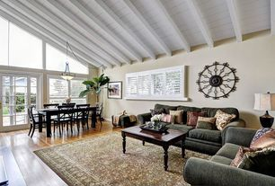 Cottage Great Room with Pendant light, French doors, High ceiling, Hardwood floors, Transom window, stone fireplace