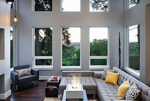 Contemporary Living Room with Hardwood floors, Nolan Sofa Chair, High ceiling, Jane bisectional sofa, Pendant light