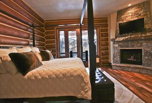 Rustic Master Bedroom with stone fireplace, French doors, Standard height, Fireplace, picture window, Hardwood floors