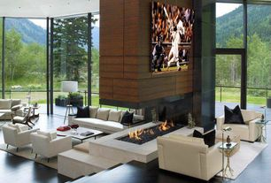 Contemporary Living Room with Tiled stone fireplace surround, Hardwood fireplace surround, Dark hardwood floors