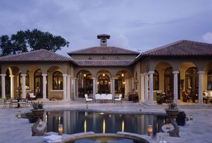 Mediterranean Swimming Pool with Casement, Pool with hot tub, French doors, exterior stone floors, Transom window