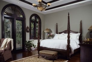 Traditional Master Bedroom with Crown molding, Laminate floors, French doors, Arched window, High ceiling