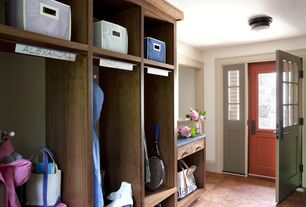 Contemporary Mud Room with flush light, terracotta tile floors, Glass panel door, Built-in bookshelf