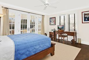 Traditional Guest Bedroom with Crown molding, French doors, Ceiling fan, Laminate floors