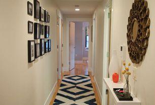 Contemporary Hallway with Built-in bookshelf, Carasa gold antique round mirror, Paint 1, flat door, Ikea black ribba frame