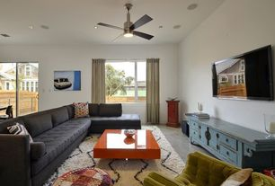 Contemporary Living Room with Ceiling fan, Concrete floors