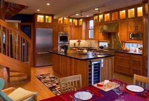 Craftsman Kitchen with Quartz counters, Pro-track tilden four-light brushed steel led ceiling light, Hardwood floors