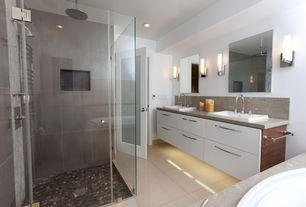 Contemporary Master Bathroom with Porcelain tile, Dupont corian dove, Strata stones polished natural mix pebble tile